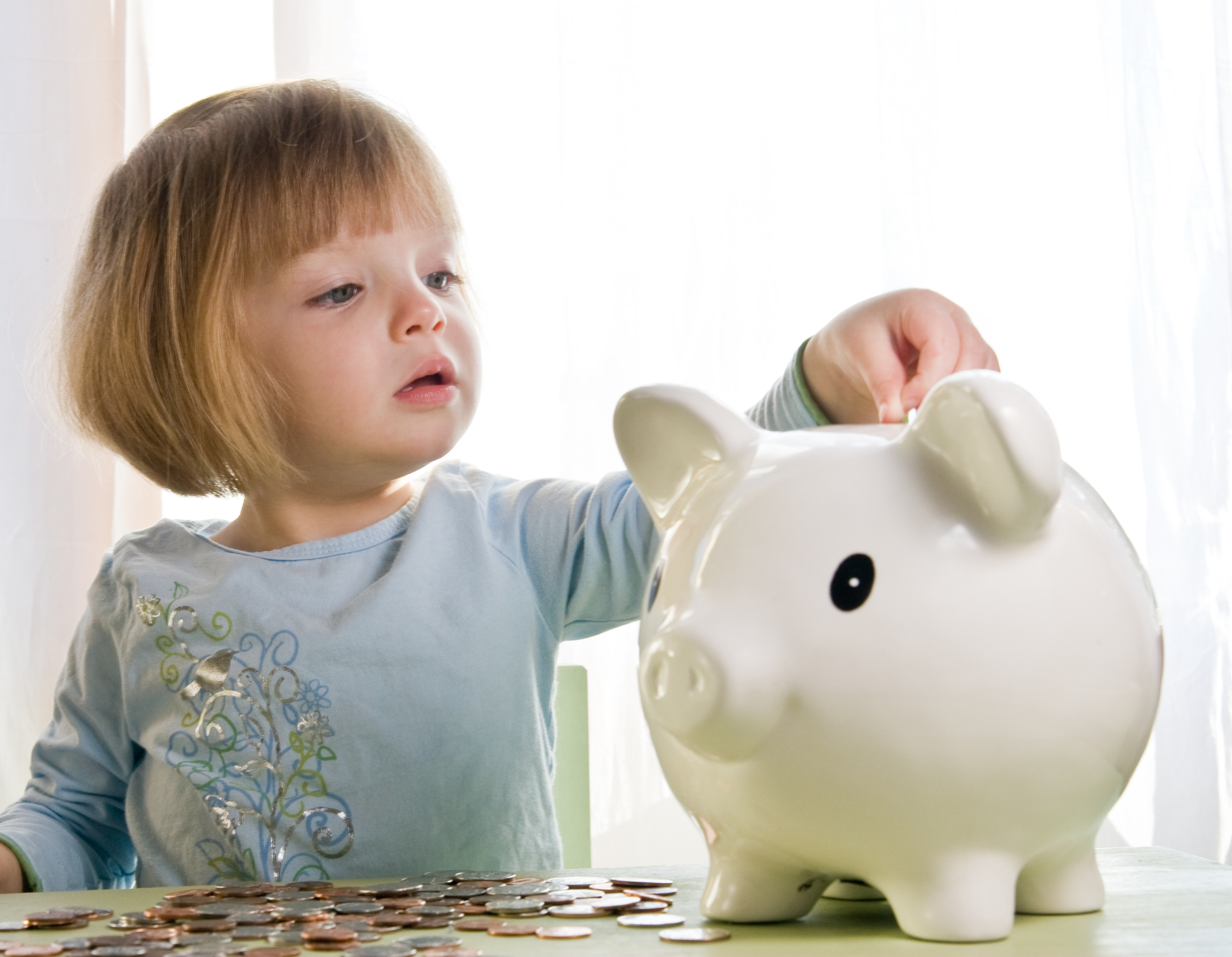 Girl piggy bank saving money