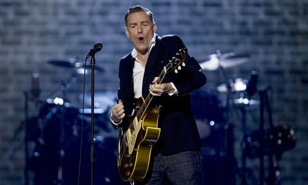 Bryan Adams performing on stage