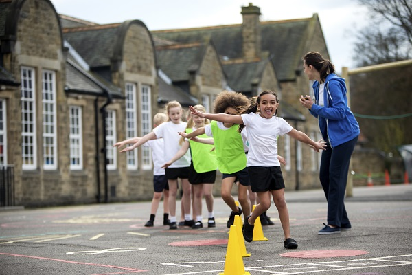 Image of children doing exercise in a school playground